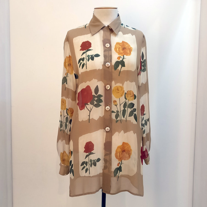 100% silk floral shirt with shell buttons.