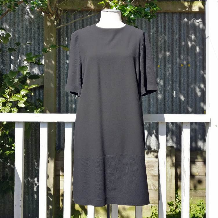 Wool mix tunic-style dress with zip pockets, lined.