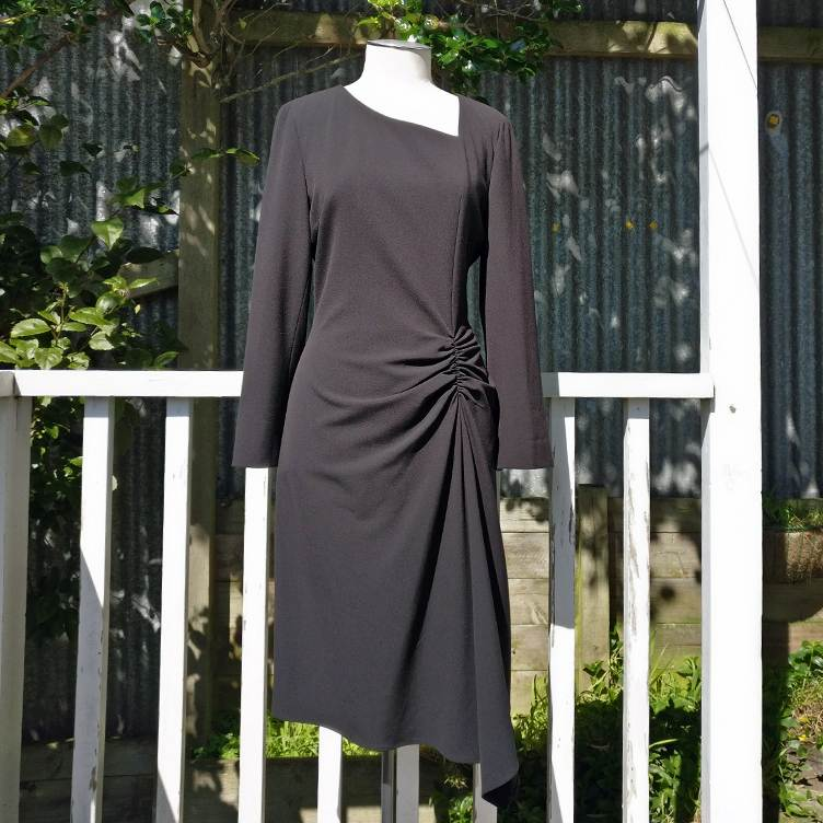 Lined dress with ruching detail.