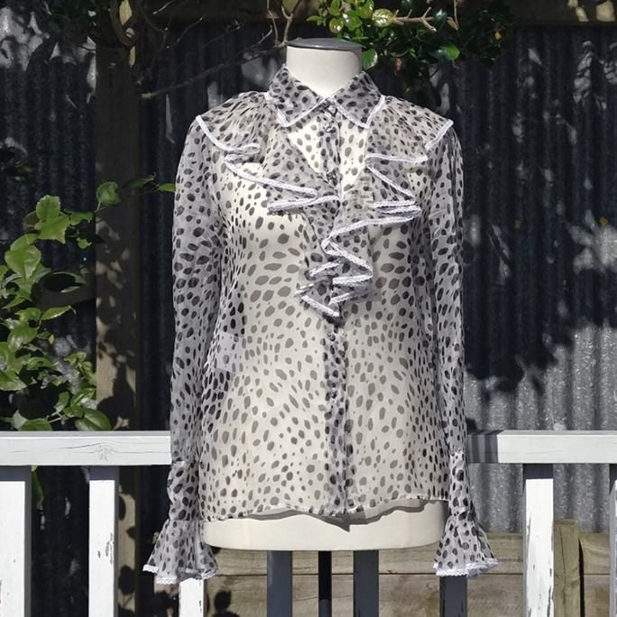 New Romantic-style animal print ruffle shirt with rhinestone buttons.