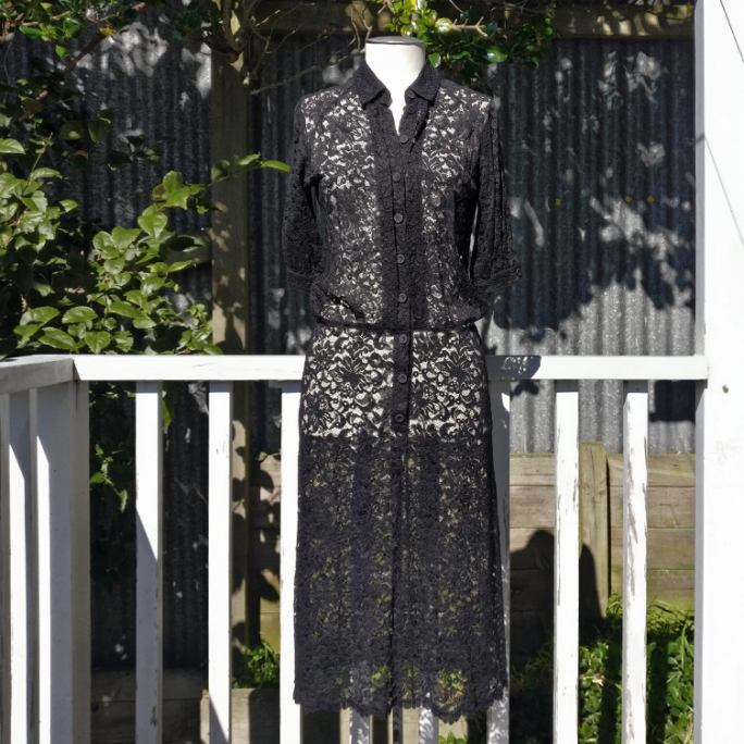 Drop-waist black lace shirt dress.