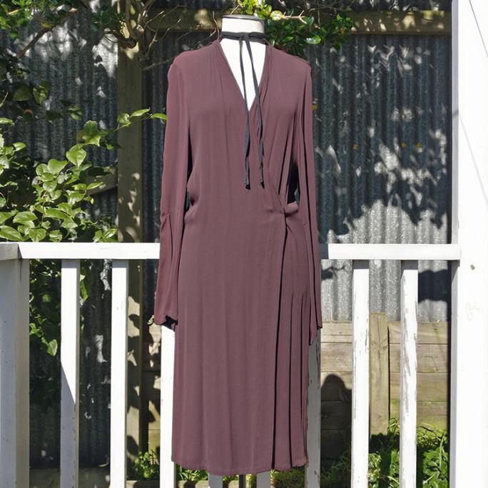 Wrap dress with neck tie detail.