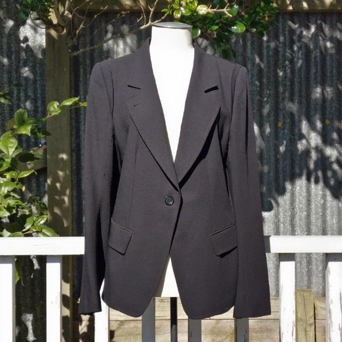 Tuxedo-style jacket, fully lined.