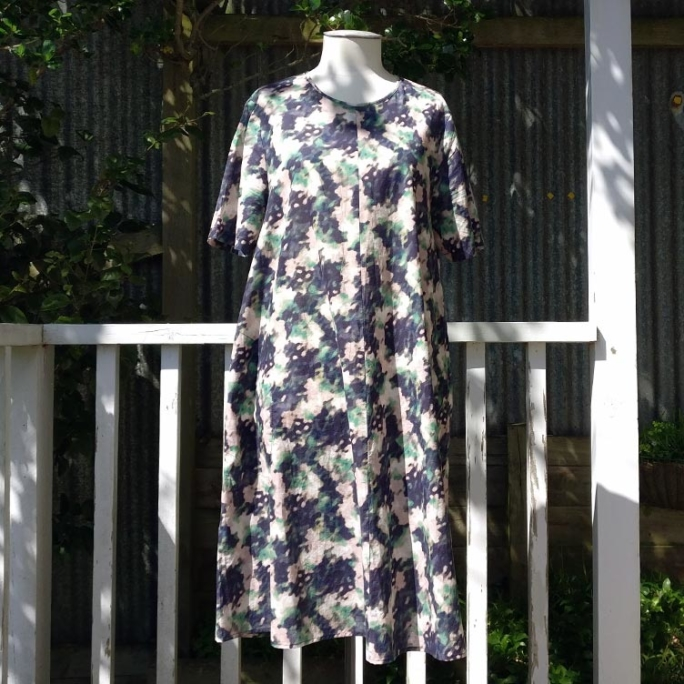 Abstract floral print dress with pockets.