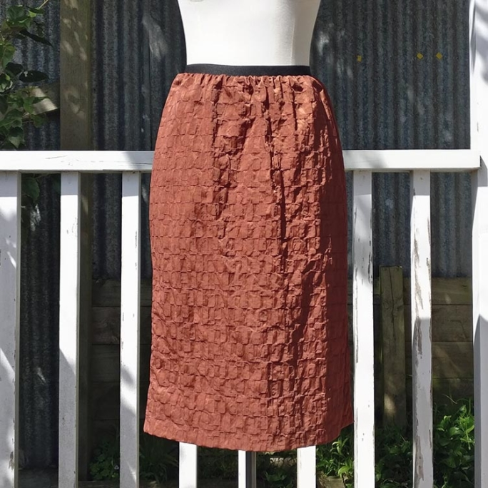 Brown skirt with pockets, unlined.