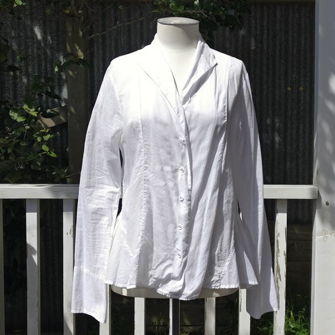 White shirt with frill bottom.
